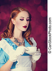 Portrait of a young redhead woman dressed as Alice in...