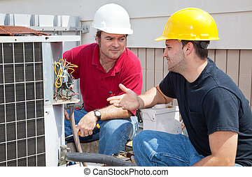 AC Technicians Discuss Problem - Air conditioning repairmen...