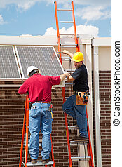 Workers Install Solar Panels - Construction electricians...