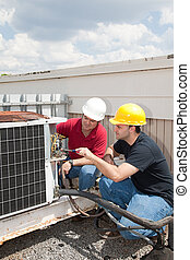 Job Training - AC Tech - Instructor trains student to repair...