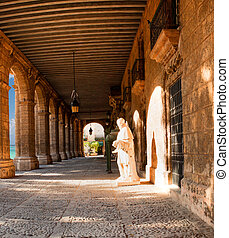 Historic building with arches and statues