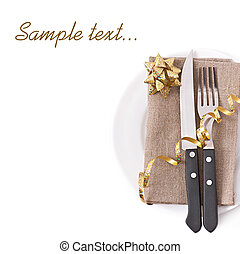knife and fork on a white plate - Close up of a knife and...