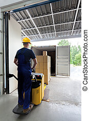 On a fork lift - Worker in uniform on a fork lift