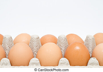 Cardboard Egg Box With Brown Eggs Close Up