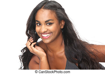 Portrait of a beautiful young woman smiling with hand in...