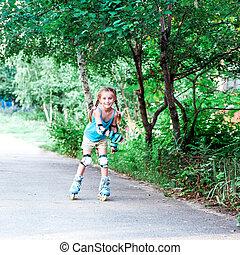 Little girl in roller skates