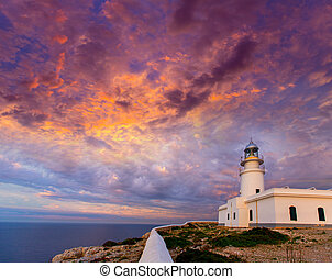 Menorca sunset at Faro de Caballeria Lighthouse - Menorca...