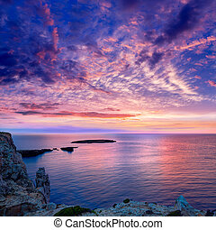 Menorca sunset in Cap de Caballeria cape at Balearic Islands...