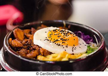 bibimbap with fried egg - closeup bibimbap with fried egg in...