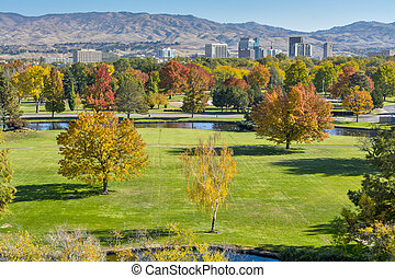 Autumn Park and Boise Idaho city skyline - Grass field of a...