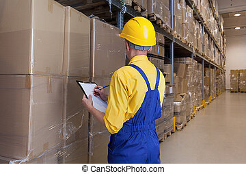 Manager checking products - Warehouse worker checking...