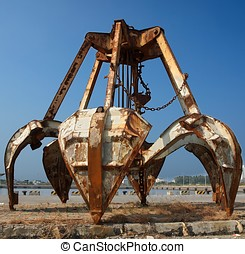 Rusty Obsolete Dredging Equipment - A large clamshell...