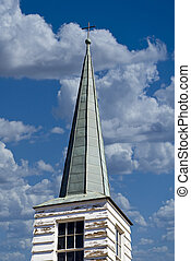 Church Steeple - Old church steeple on cloudy day.