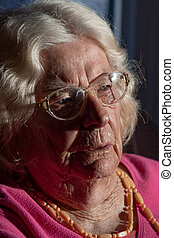 In deep thought - Closeup of an elderly woman in deep...
