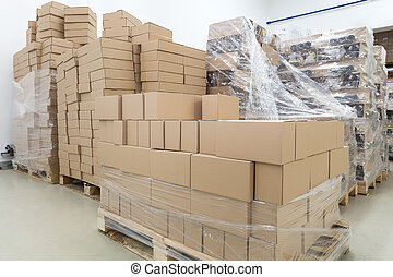 Boxes in warehouse - Empty cardboard boxes in a warehouse