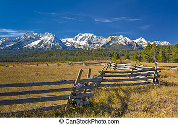Idaho mountain range and log fence with snow - Zig Zag fence...
