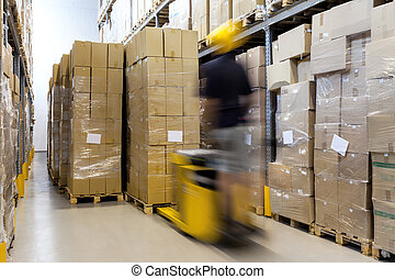 Fork lift at work - Fork lift with operator working in...