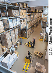 Work in a warehouse - Products on a metal stillage, pallet...