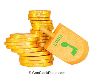 Stacks of Chanukah coins and large wooden dreidel - Dreidel...