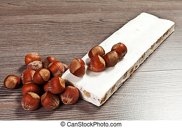 nougat on the wood table with hazelnuts