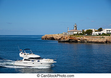 Ciutadella Sa Farola Lighthouse with yatch boat in Balearic...