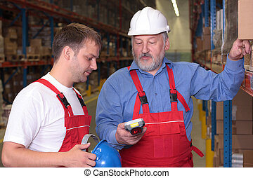 senior engineer training a newly hired - A view of a senior...