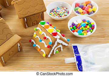 Gingerbread Houses being Made - Horizontal photo of parts of...