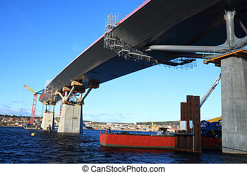bridge construction reaching over water, view from beneath....