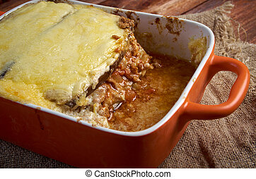 Lamb moussaka with egg plant cheese in baking...