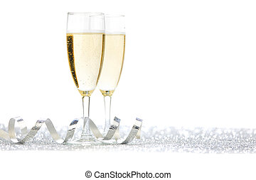 Two champagne flutes and decoration on gold shiny background