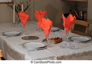 Table set for two couples for dinner