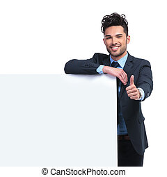 business man with  blank board making the ok thumbs up gesture