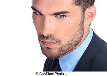 closeup picture of a serious young business mans face on...