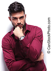 pensive casual man looks at you - pensive young casual man...