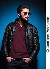 side view profile of a young bearded fashion man in leather...