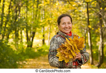 mature woman in autumn - Portrait of mature woman in autumn...