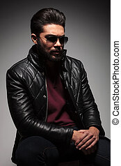 artistic pose of a dramatic fashion young man with beard...