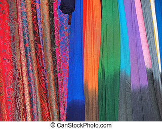 hanging scarfs - Pile of gentle folded shawls (scarfs)...