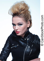 woman in leather jacket wearing beautiful make up