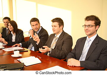Five business persons at a Conference
