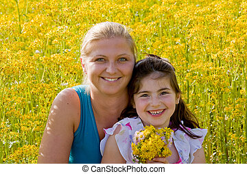 Mother Daughter - Mother and Daughter in a Flower Field