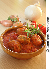 Meatball on the table with tomato sauce