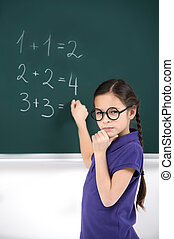 She knows the answer Confident little schoolgirl thinking...