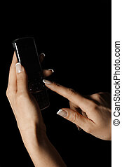 Dialing - Manicured hands at dialing number on phone