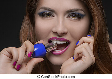 I choose the blue one Portrait of beautiful women holding a...