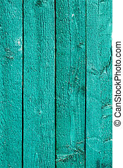 Green painted wooden fence - Detail the fence of parallel...