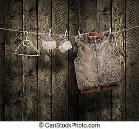 womens winter clothes on a clothesline