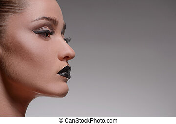 Fashion look. Side view of beautiful women isolated on grey