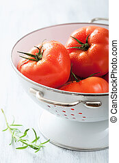 fresh tomatoes in colander