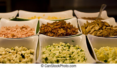 Salad Bar Vegetables and Meat - Cut vegetables and meat at a...